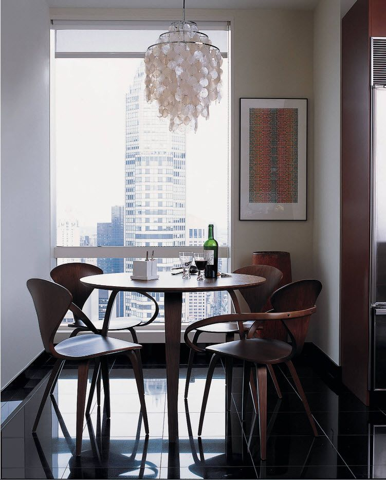 Casual urban interior of the dining room with natural furniture