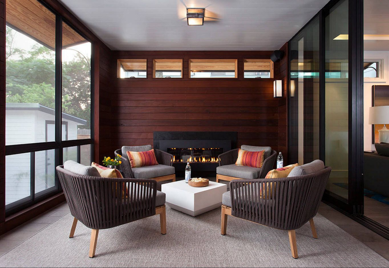 Dark noble wood to trim modern styled porch terrace