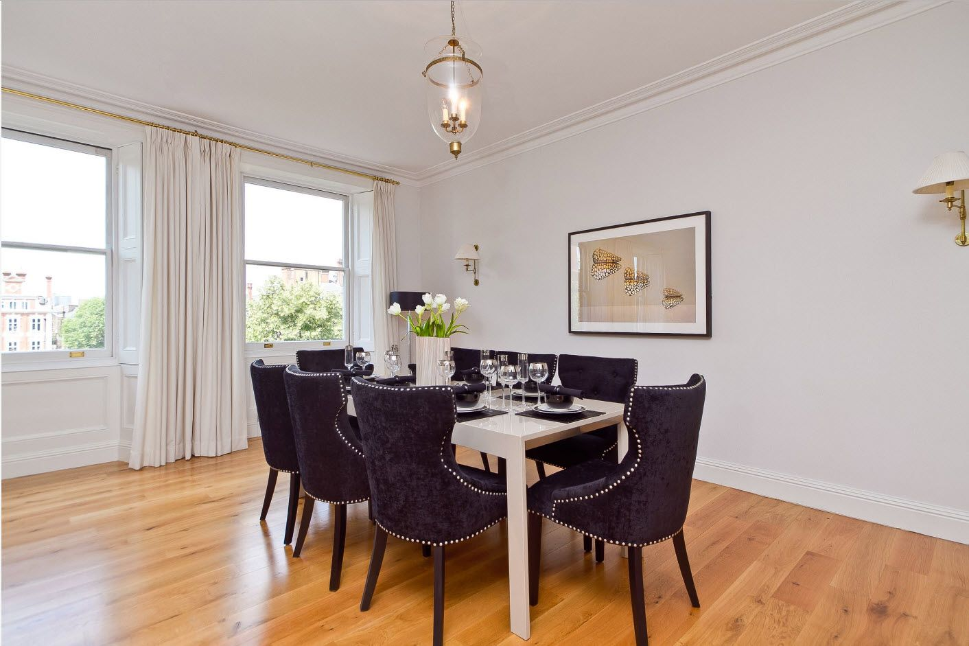 Minimalistic setting in the spacious dining room with dark puple upholstered armchairs