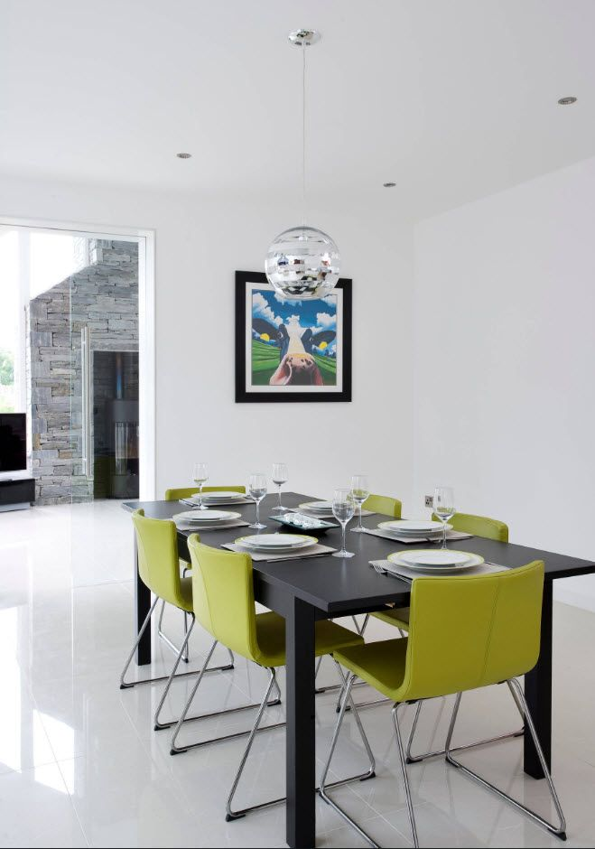 Unusual lime chairs in the spacious white designed modern dining