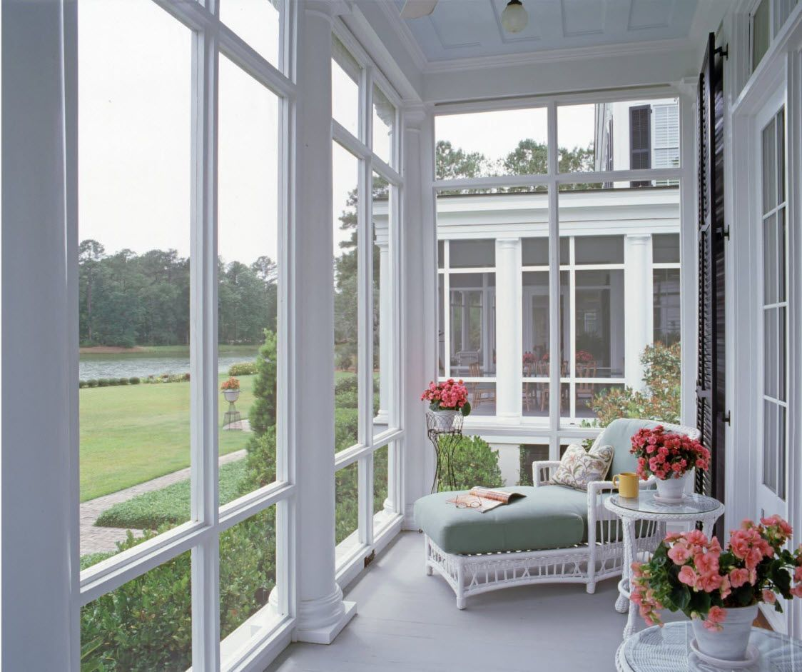 White and gray tones for the open terrace at the porch with latticed windows
