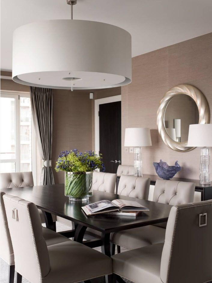 Leather upholstered quilted chairs in the gray toned modern dining room