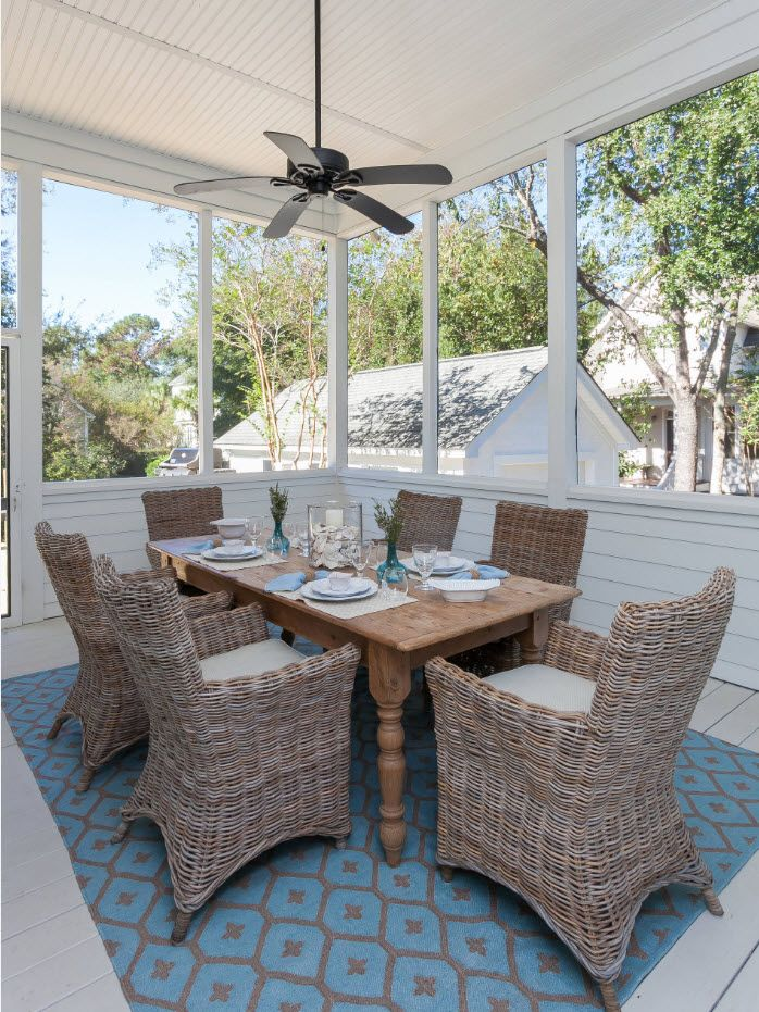 White styled porch with dining zone for large company