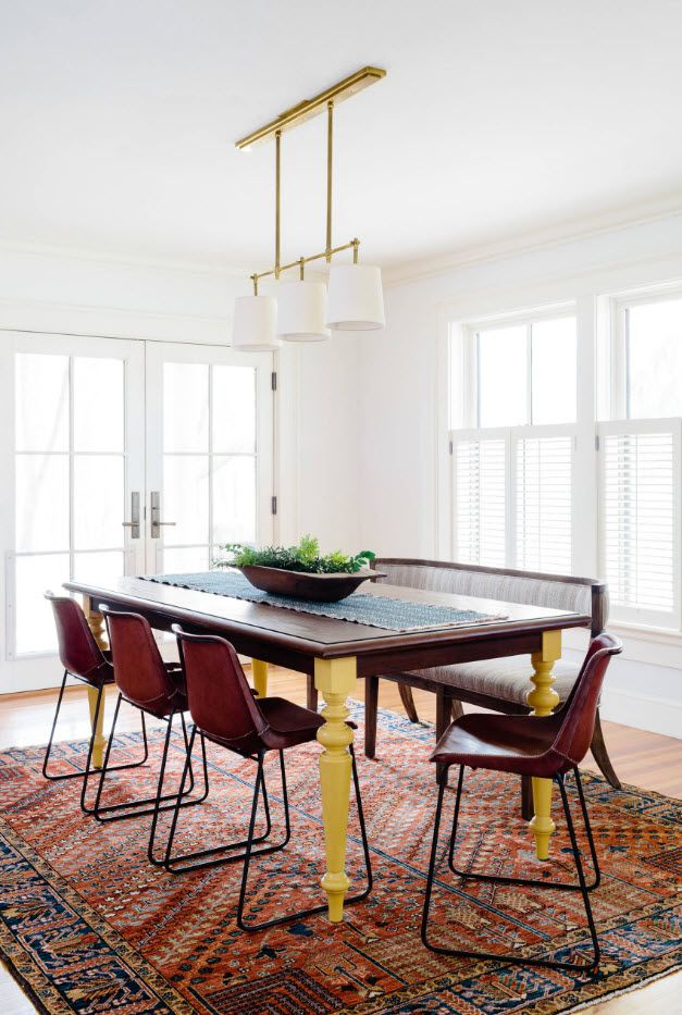 White design of the dining room with rectangular table and wooden stools