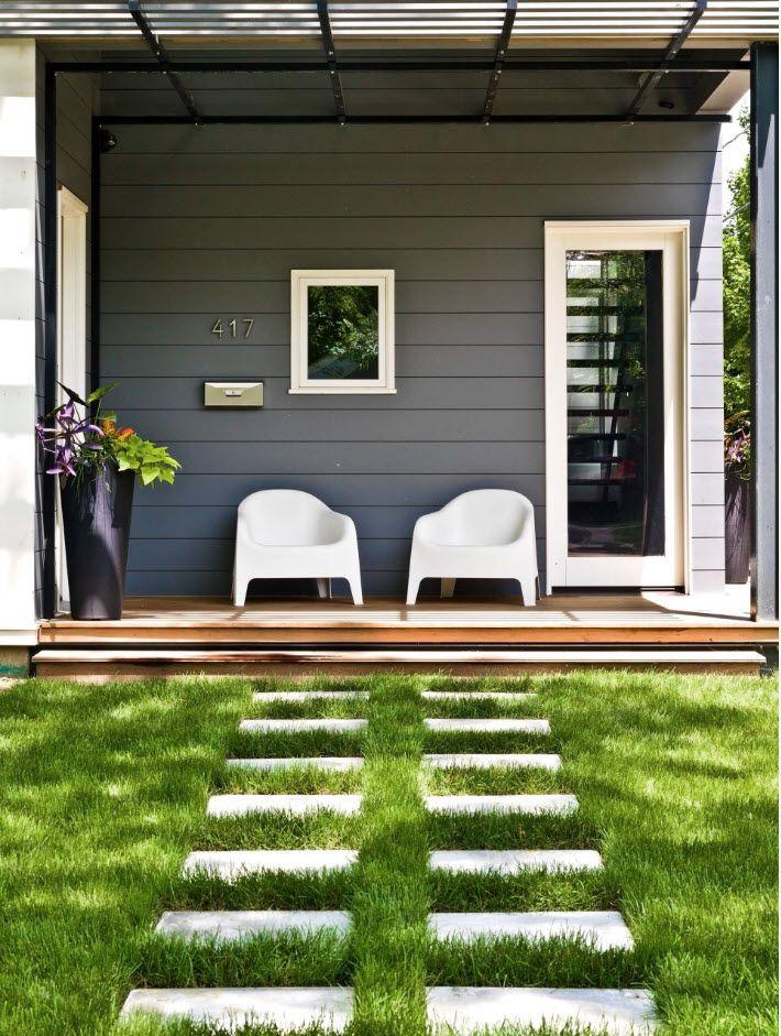 Gorgeous green lawn with concrete slabs to pass through