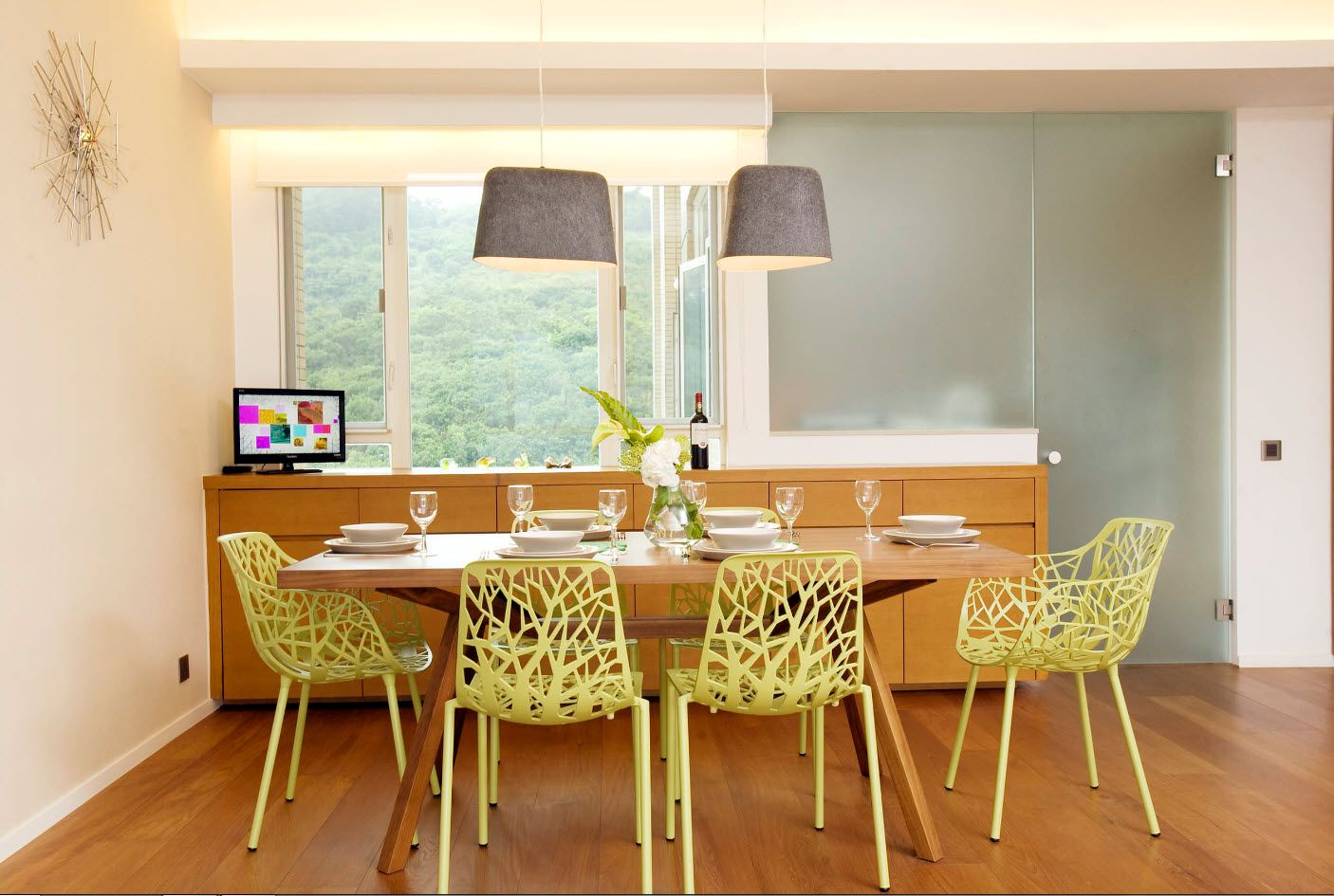 Dining Zone Table and Chairs: Practical and Aesthetic Composition. Wrought green chairs are aliens to overall atmosphere