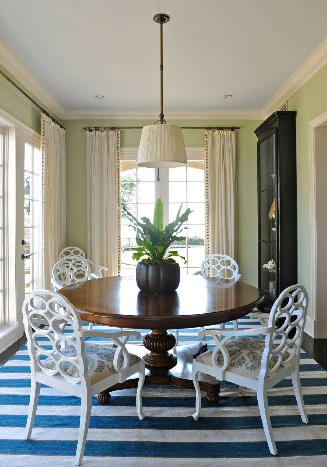 Classic dining with large curtains and Marine styles striped rug