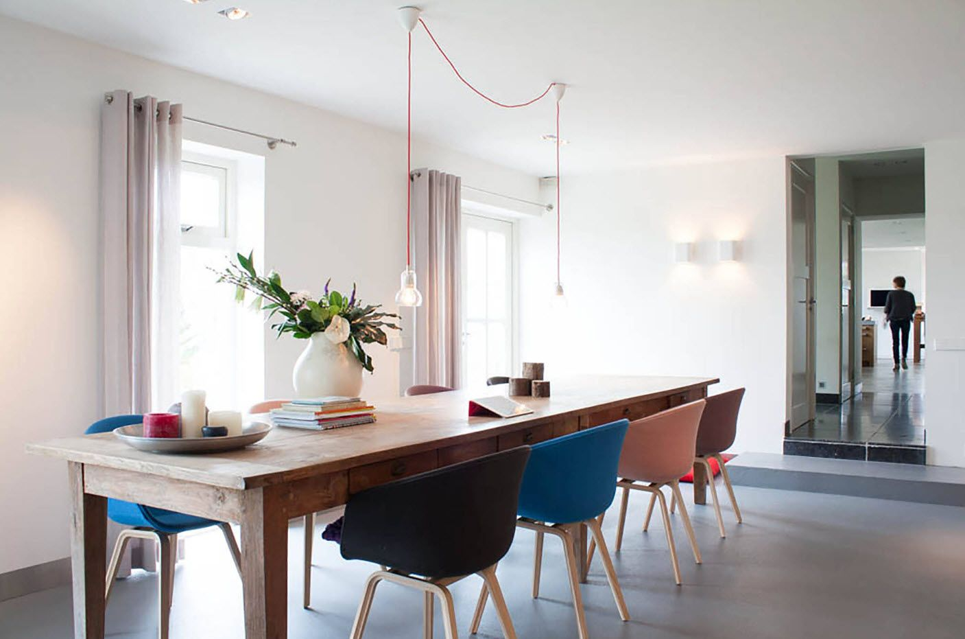 Dining Zone Table and Chairs: Practical and Aesthetic Composition.  Scandinavian minimalism and the lamp with open cord