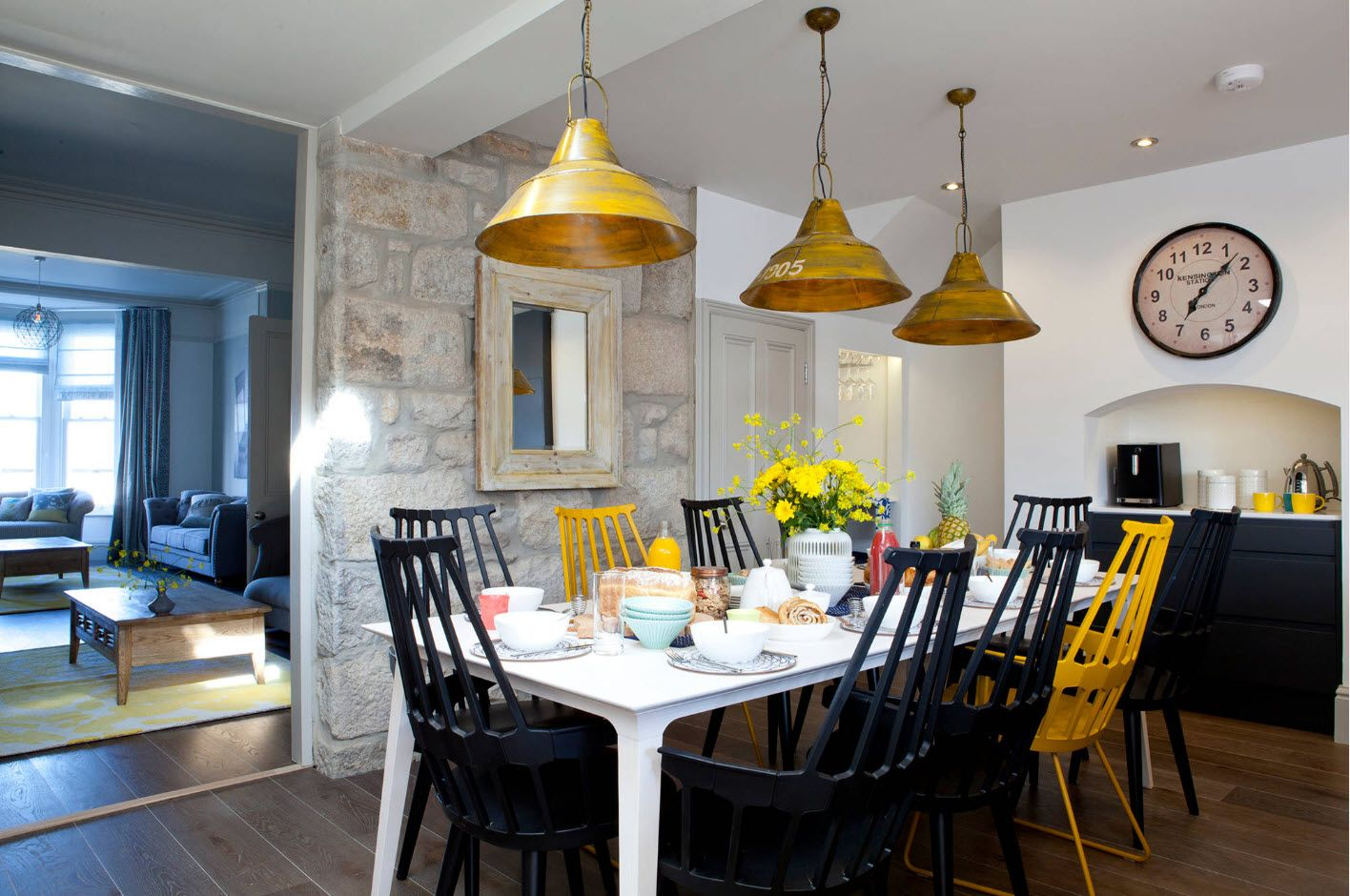 Dining Zone Table and Chairs: Practical and Aesthetic Composition. Gold lampshades adding a touch of pomposity into modern interior