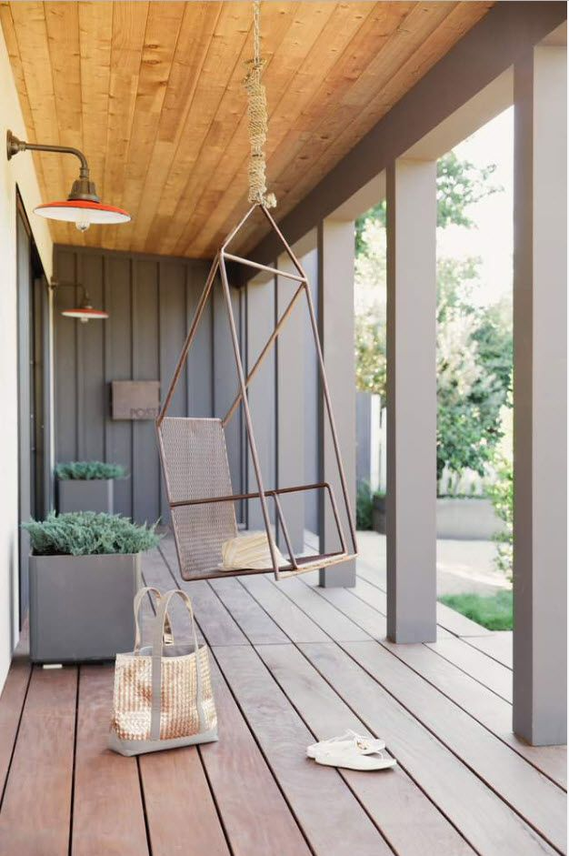 Modern casual styled porch of the private house in gray tones and with broad panels of the slightly lifted platform