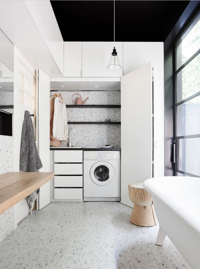 Laundry & Bathroom Combining Ideas with Photos. Built-in washing machine and cabinet for clothes with sliding door