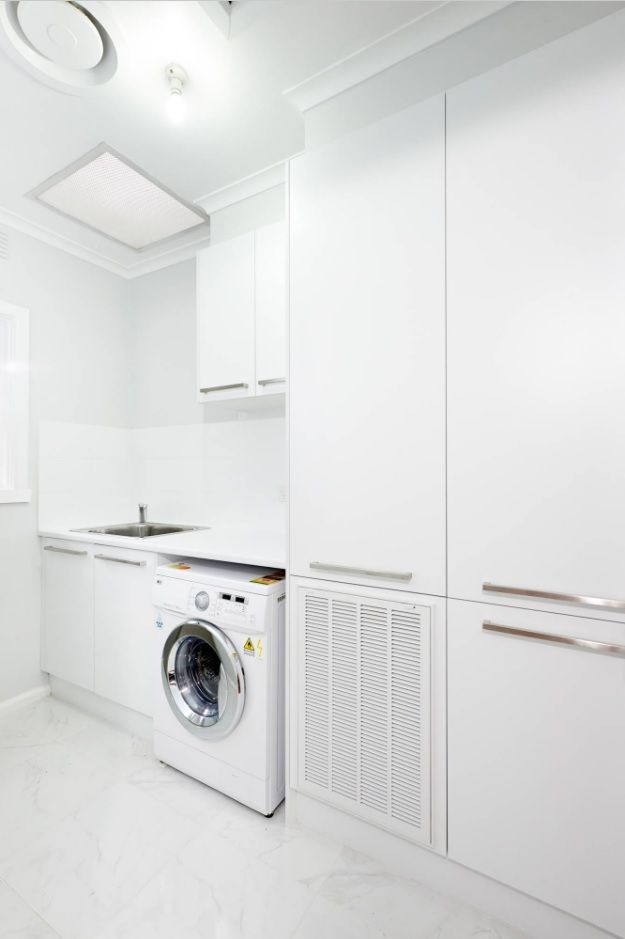 Absolutely white room interior in minimalsitic style with all necessary appliances