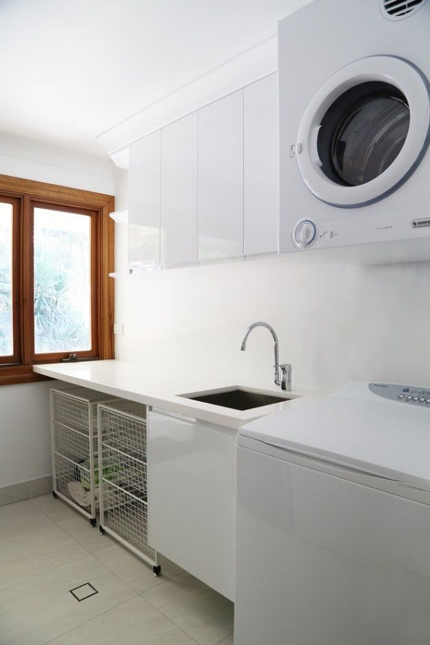 Laundry Allocation Options for Modern Home Interior. Separate premises with pronounced wooden window frame
