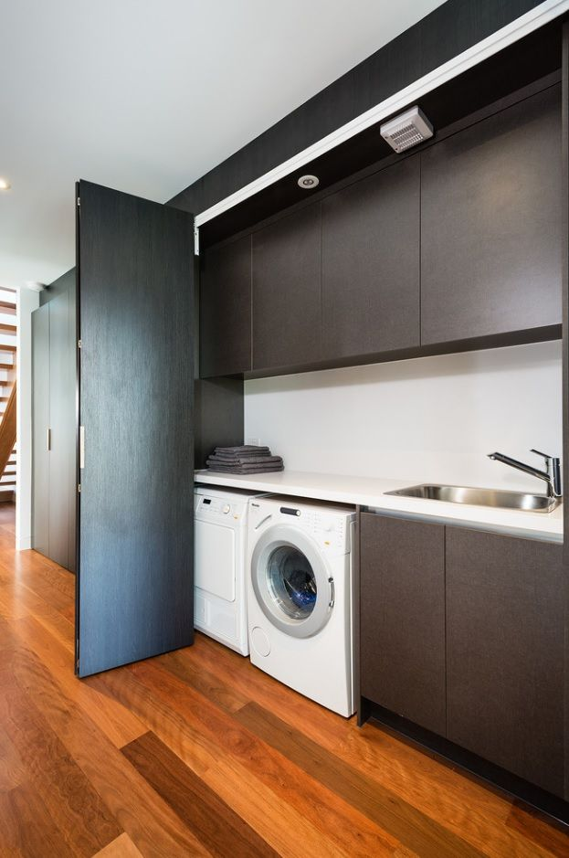 Laundry Allocation Options for Modern Home Interior. Nice idea of dining partitioning to place washing and drying machines