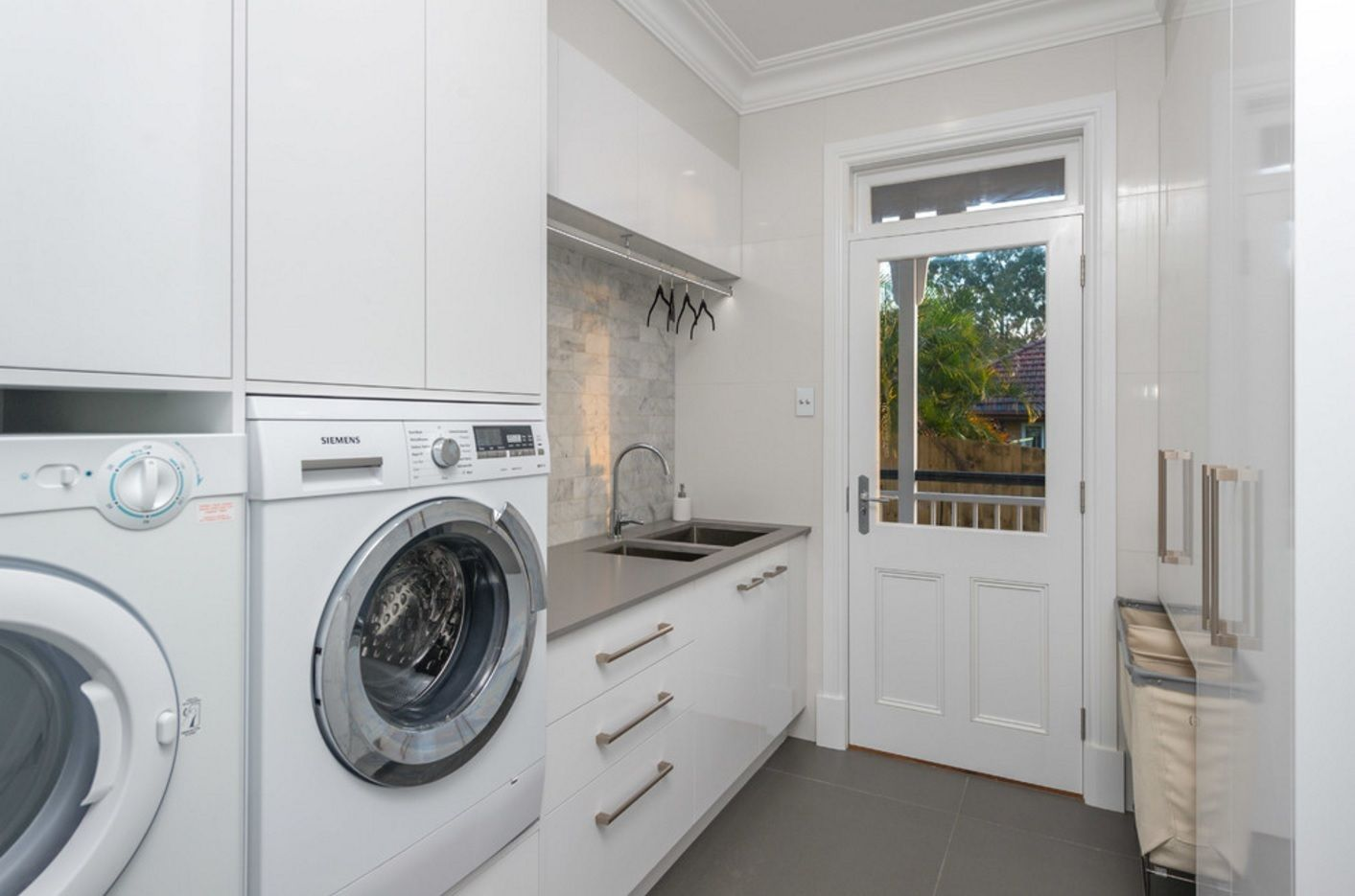 Laundry Allocation Options for Modern Home Interior. A place at the door to the backyard