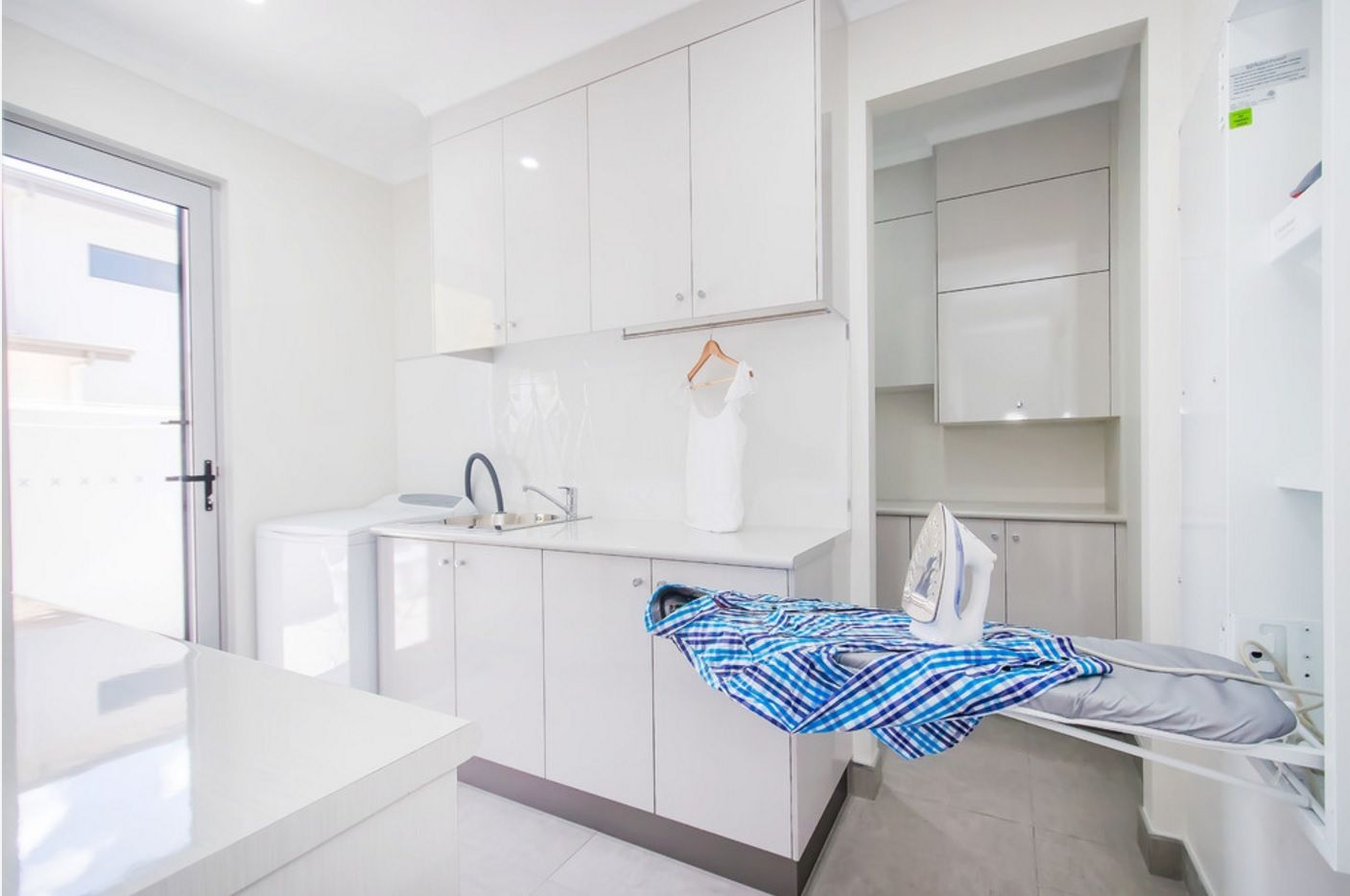 Laundry Allocation Options for Modern Home Interior. Separate room in the large house