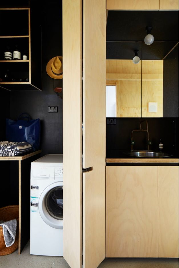 Laundry Allocation Options for Modern Home Interior. Natural materials and wooden partition to hide the appliances