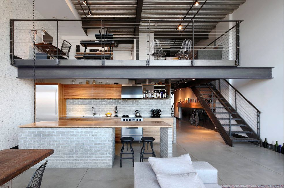 Typical loft multilevel apartment with white painted walls and dark metal constructions