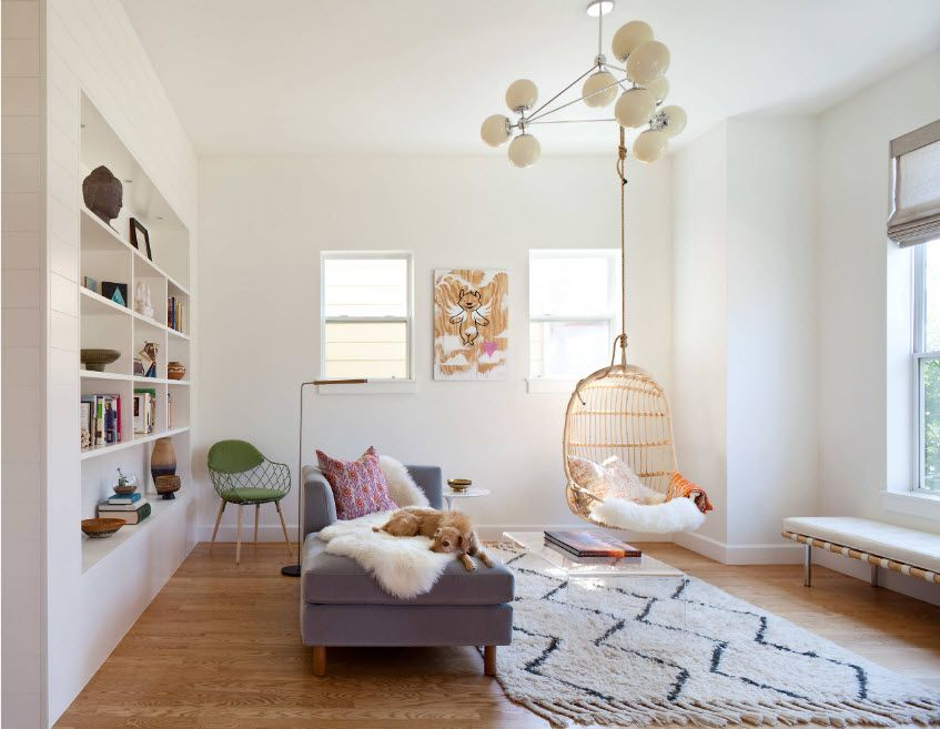 Elaborated neat kids; room interior with wicker hanging armchair