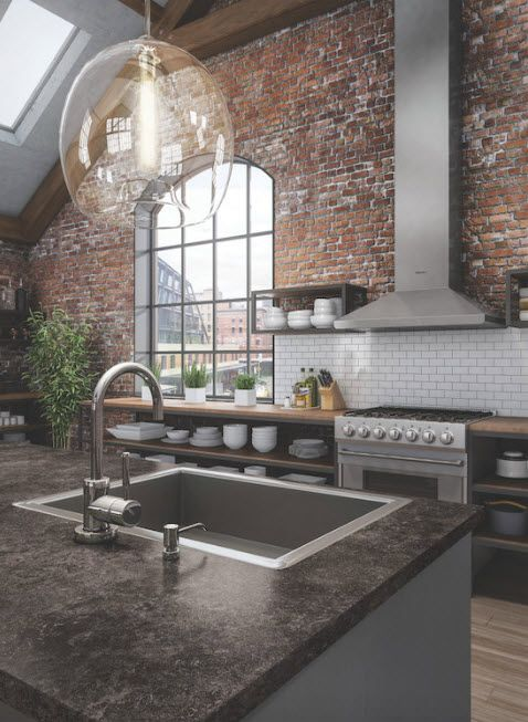 Raw bickwork wall with arch window and large kitchen island with sainless steel sink