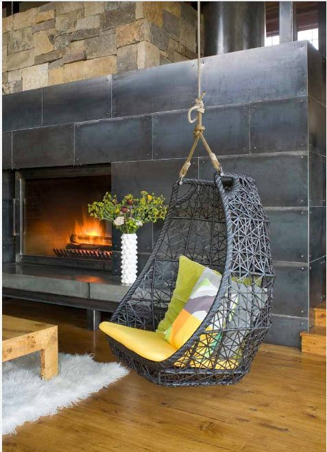 Wicker chair looks like it is forged construction in the large living with fireplace