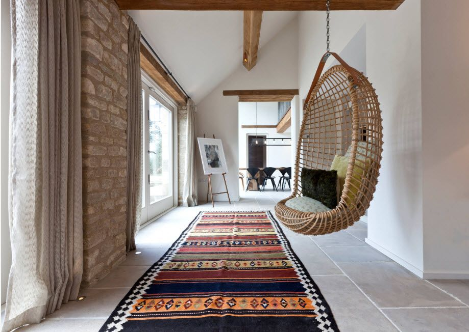 Elongated room with wicker suspended chair