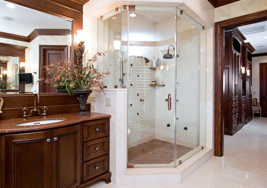 Classic styled interior in white color and wooden materials with shower cabin equipped with hydromassage