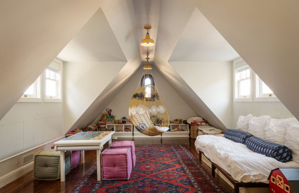 Loft room with abruptly slants of ceiling and full of light