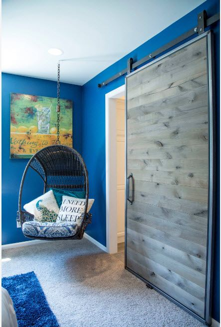 Blue painted walls for the unexpectedly decorated room for boy
