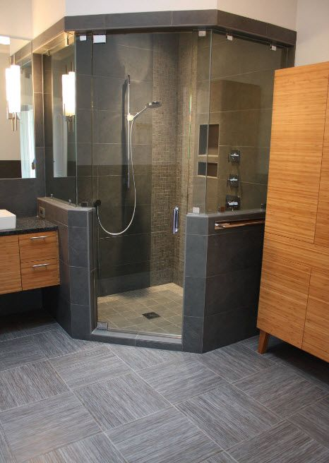 Modern Bathroom Interior Shower Cabin Design. Gray stone finshing and wooden cabinet