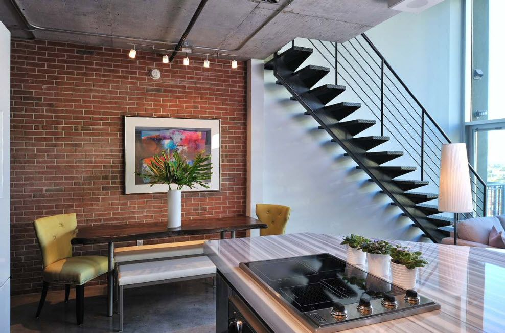 Loft Styled Kitchen. Industrial Motiffs for Comfortable Life. Accent brickwork wall with the picture and open steel framed stairs