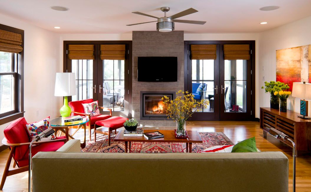 Artificial Fireplace as Part of Comfortable Life. Gray chimney shaft with TV located at the top