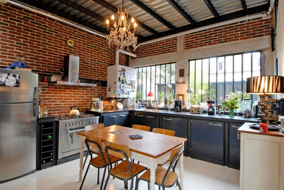 Loft Styled Kitchen. Industrial Motiffs for Comfortable Life. Red brick wall and open dark ceiling beams