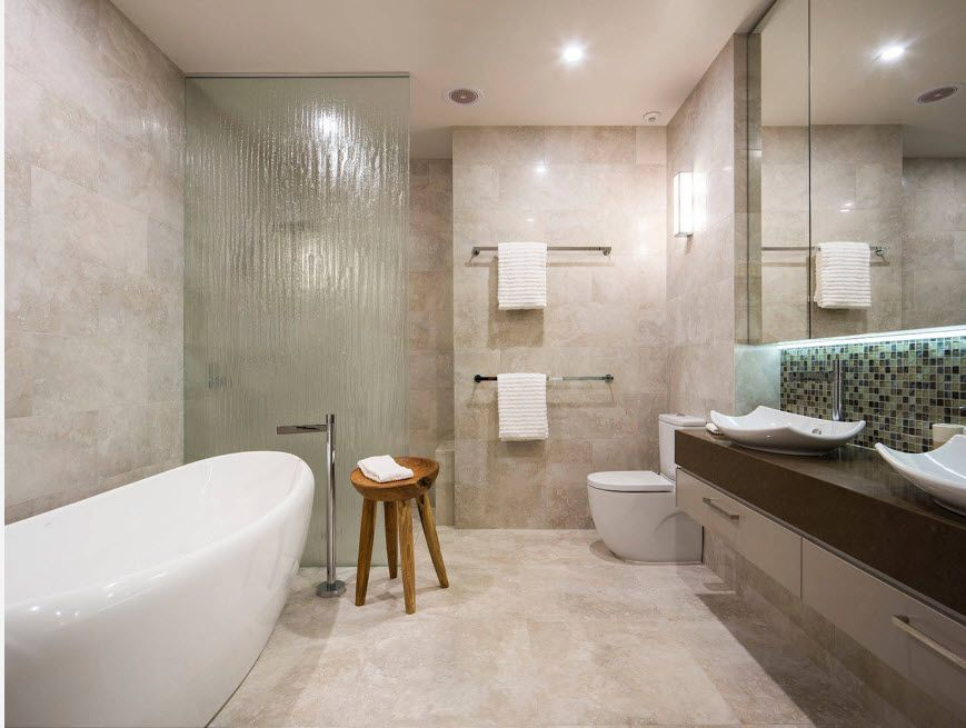 Gray color theme for modern styled bathroom with classic notes and artificial stone bathtub