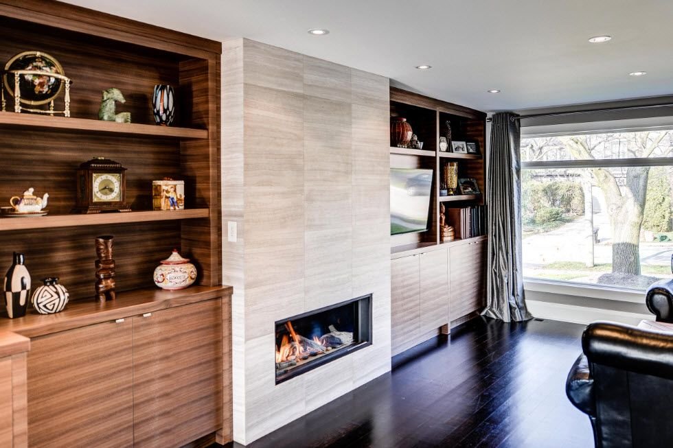 Artificial Fireplace as Part of Comfortable Life. Modern full of natural light living with bottom located fireplace