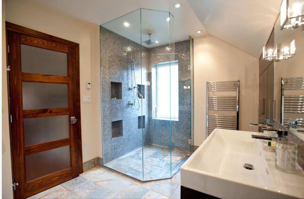 Glass shower cabin with straight floor and gray mosaic