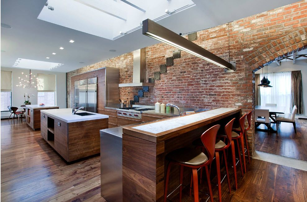 Raw brickwork and lacquered wooden island with long lamp above it