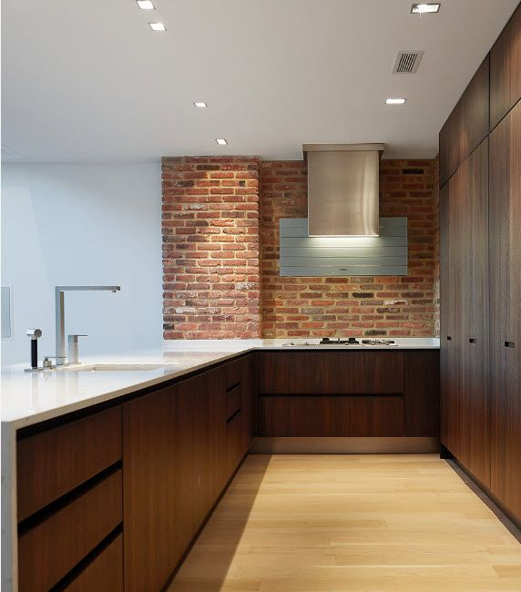 Loft room style and notes of hi-tech design in the kitchen with dark wooden furniture