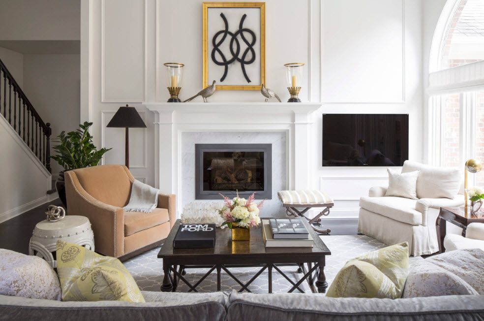 Artificial Fireplace as Part of Comfortable Life. Classic white interior finishing with Victorian decorative elements