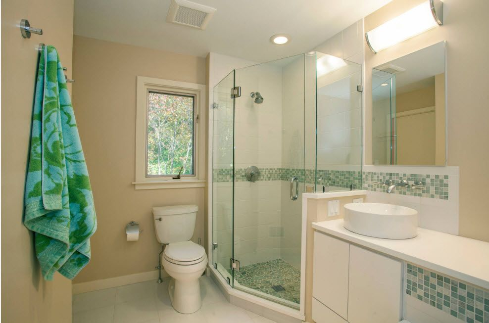 Light Classic interior design of the private houses's bathroom with the transparent light shower cabin