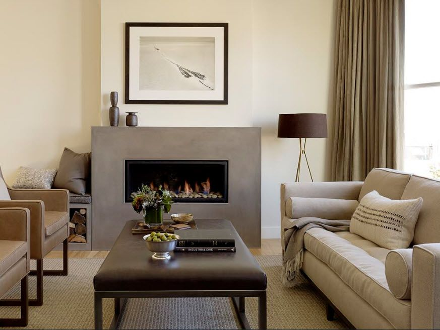 Artificial Fireplace as Part of Comfortable Life. Pastel color set of the room and gray finished chimney