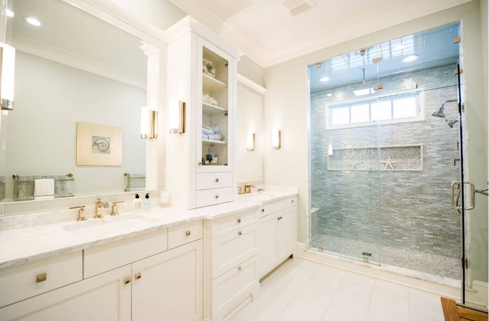 Milky matted paint for the classic bathroom with golden fittings and accentual glass cabin