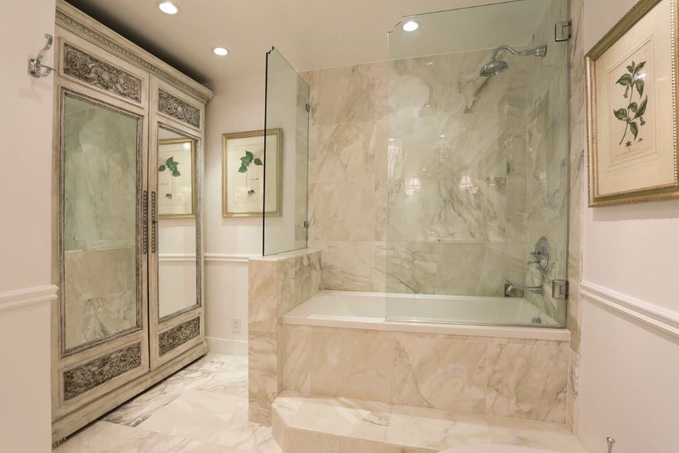 Marble royal bathtub finishing and glass partition against spashes