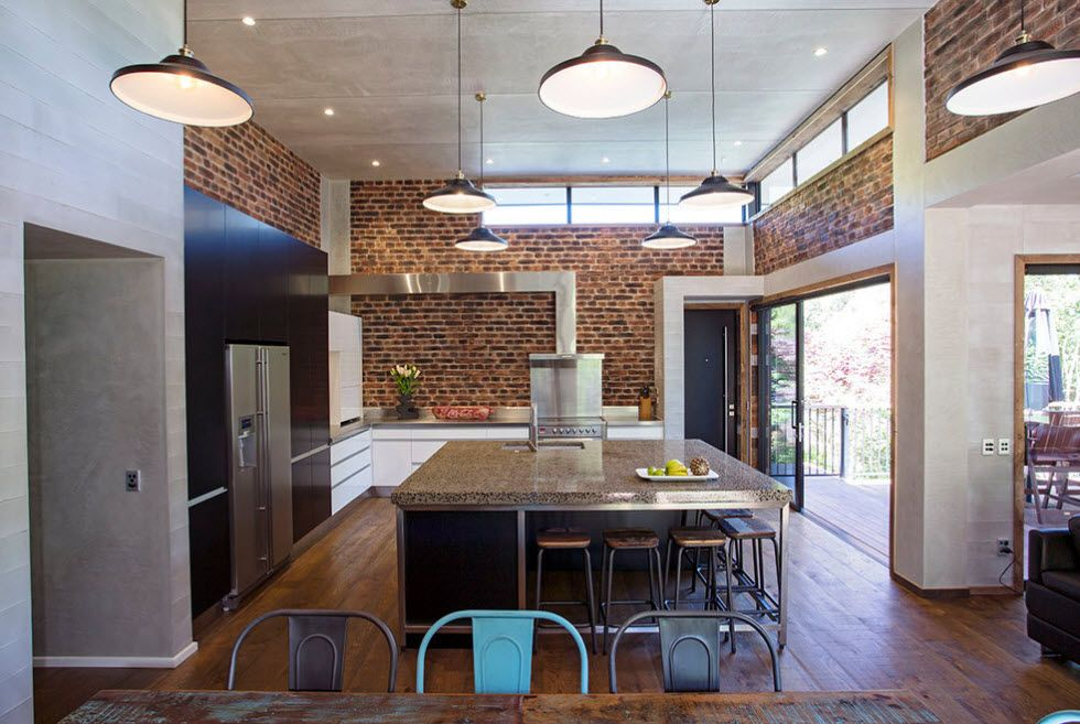 Usual industrial motiffs for the open layout kitchen with raw untreated brick walls