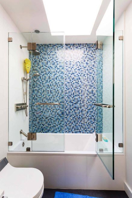 Glass Bathroom Screen. Types, Design, Interior Application. Nice blue mozaic at the shower zone
