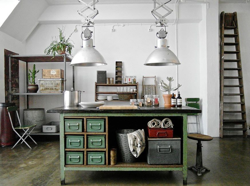 Loft kitchen with alternative color scheme and powerful white metal hanging lampsover the island