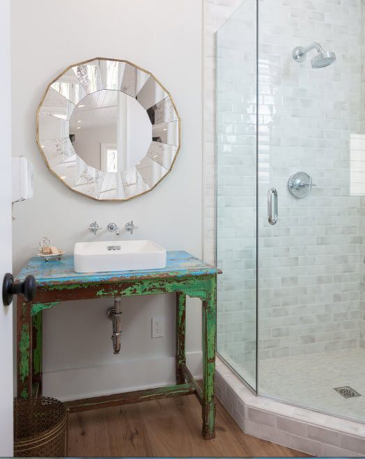 Peculiarly framed with kaleidoscope small sectors mirror in the Classic styled bathroom