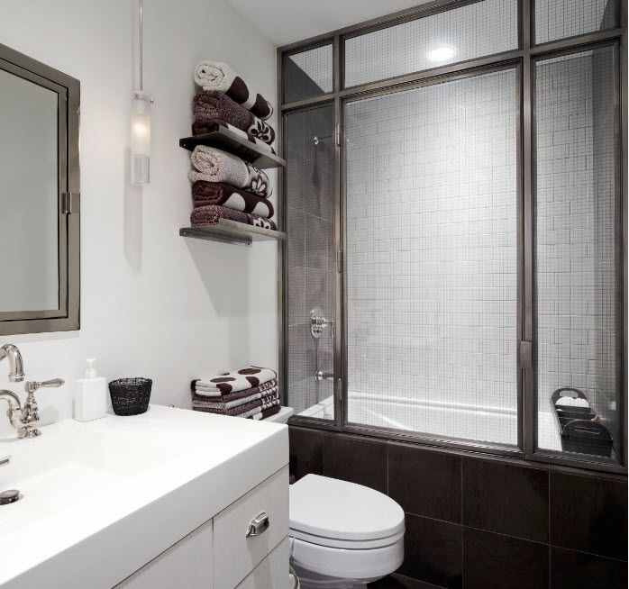Dark wooden frame for the shower cabin with frosted glass