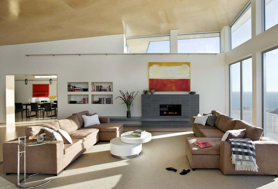 Artificial Fireplace as Part of Comfortable Life. Spacious area with small gray artificial chimney