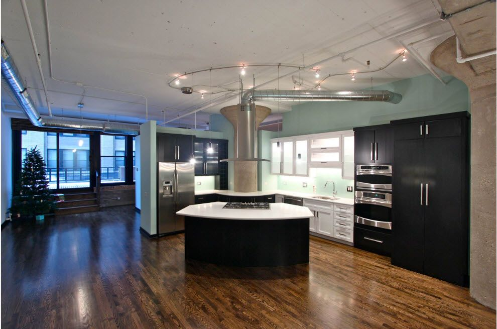 Loft Styled Kitchen. Industrial Motiffs for Comfortable Life. Rare design idea of triangular kitchen island in the center of dark colored premises